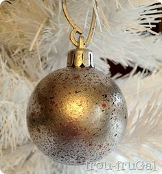 Faux Aged Christmas Bulbs - spritz with water, paint, dry and brush off bubbles.