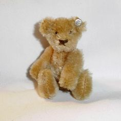 Old Tan Mohair Steiff Teddy Bear with Silver Button.