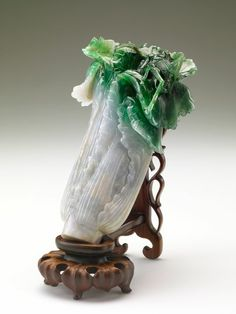 Fresh as the day it was carved, 400 yr-old Qing Dynasty jade cabbage. Spot the katydid!