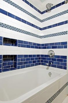 blue and white tiled shower/bath