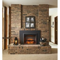 decoration captivating electric fireplace insert heater manufacturer with wire wine cork basket and black metal candle lanterns above raised brick fireplace hearth Brick Fireplace, House, Fireplace Accessories, Masonry Fireplace, Farmhouse Fireplace, Fireplace, Great Rooms, Living Room Designs, Fireplace Inserts