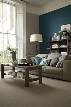 my ideal home, grey couch and blue on walls