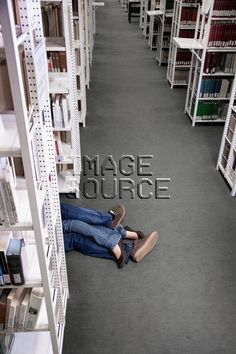 Couple lying on floor in library, 18 to 19 years, 20 to 24 years, adult, aisle, couple, crop, cropped, desire, educate, educating, education, eroticism, Fancy Images, female, floor, indoors, learning, library, man, people, two, two people, young adult