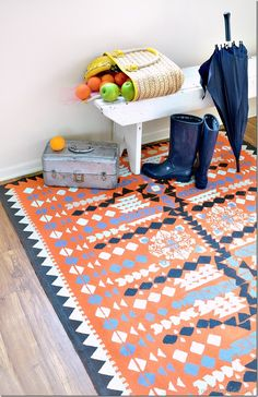 make a rug with a dropcloth and paint. Full tutorial.