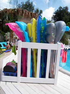 Genius A Painted Pallet Serves As A Towel Rack And Pool Noodle Storage Http Www