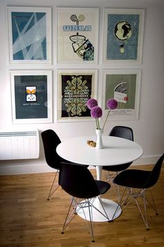 Sneak Peek: Rion Nakaya. Poster collection with the Saarinen dining table from Knoll and DSR Eames chairs from Vitra. Hackney, London.