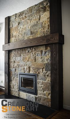 Fireplace done with Kiamichi Natural Thin Stone Veneer from Robinson Rock. Black porcelain tile for Hearth.