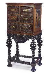 A PORTUGUESE BRASS MOUNTED ROSEWOOD CONTADOR  19TH CENTURY, OF EARLY 18TH CENTURY STYLE  The cabinet with a moulded top and four variously sized panelled and ripple moulded drawers, the sides with similar raised panels and decorated with brass strapwork clasps throughout, the stand with a scrolled foliate apron and bulbous spiral turned legs joined by similar stretchers and with turned feet 50½ in. (129 cm.) high, 25½ in. (65 cm.) wide, 16½ in. (42 cm.) deep Baroque Furniture, Disney Little Mermaids, English House, Raised Panel, Furniture Styles, Art Decor, Home Decor, 18th Century, Cabinets