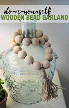 How to create your own wooden bead garlands for less than $10. Super cute and simple home decor project that only requires a couple materials.