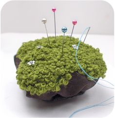 "adorable ""moss on a rock"" pincushion.  i love keykalou's patterns and have made loads of purses from them.  the ""moss"" is just lots of little french knots. :)"