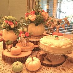 fall bridal shower centerpiece using painted pumpkins with gold glittered stems beautiful roses and rustic