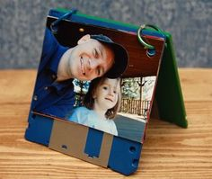 DIY Dad's Brag Book by innerchildfun: Geeky photo album the kids can make with upcycled computer discs and binder rings. #DIY #Kids #Fathers_Day_Gift #Photo_Album