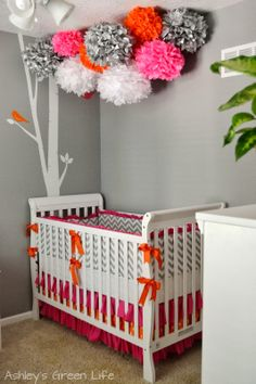 Tissue or paper flowers above crib or beds