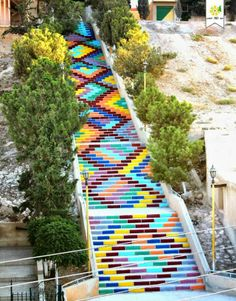 """A group of inspired young Syrian students recently painted the longest public stairway in their hometown with vibrant geometric patterns. The project aims to make the environment brighter and more beautiful through color, bringing joy to the local inhabitants, who are currently facing both political and social hardship. Salmo Al-Batal explains, """"Syria today is not the land of blood colors, so we are trying to make a little difference for love and peace in the war zone."""""""