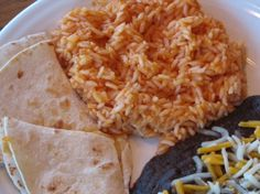 Mexican Rice ~ I substituted the tomato sauce for El Pato sauce in the yellow can. It's gives the rice a spicy flavor & was a hit with 2 of my 3 little stooges. I also doubled the recipe to ensure left overs.