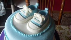 Gum paste baby shoes  https:/www.facebook.com/hercakery