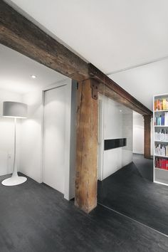 Asgoneaudesign - Espace Le Moyne - old beams with clean walls and glass...