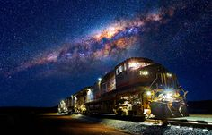 A train and the Milky Way. The photo was taken in the Pilbara, that's the Northern region of Western Australia. By Matt Hutton. Night Photography, Landscape Photography, Railroad Photography, Color Photography, Surfing Ireland, Milky Way Stars, Cool Pictures, Cool Photos, Night Train