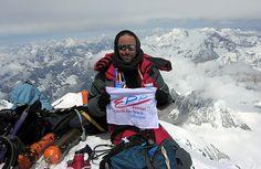 a climber summiting Mt. Everest