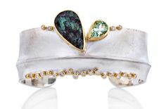 Fold-formed sterling silver cuff bracelet with 18k gold, 14k gold, natural surface green tourmaline, green beryl and .76 tcw diamonds by Danielle Miller