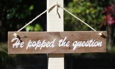 'He popped the question' reclaimed timber sign is approx 62cm long by 14cm high.  Great for an engagement party or photo prop.  Made to order, please note your sign is unique and may vary from the one pictured, (which was used in a barn style engagement party)
