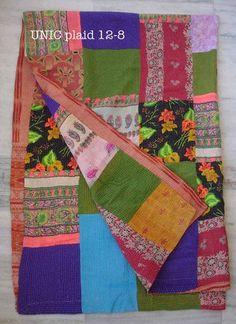Nos plaids vintage sont des pièces uniques en textile ancien, piqués sur toute leur longueur à la main.    Des saris anciens ont été superposés puis piqués à la main. Certains sont patchés, d'autres reprisés...    Leurs dimensions sont très variables : environ 1.2x2.8 m    Ces pièces que nous mettons en vente seront livrables courant Mai 2012.