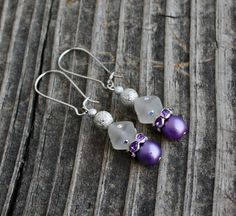 Swarovski Elements & Lavender Druk Bling Earrings $11.00 These+gorgeous+earrings+will+be+the+envy+of+all+of+your+friends.++They're+made+with+lavender+druk+satin+finish+glass+beads,+silver+plated+lavender+rhinestone+wavy+spacers,+silver+stardust+beads+and+frosted+Swarovski+elements+bicone+beads+on+silver+plated+kidney+wires.