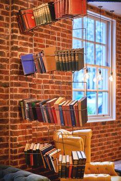 Book shelf display. Wire coat hanger style feature. Wall screen divider details. Bar & Restaurant Design by Tibbatts Abel. Saint Paul's House. www.tibbattsabel.com