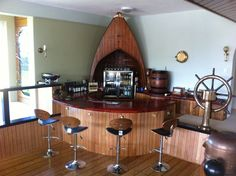 taking the use of wood ideas here.I don't like the stools but wood work is nice. Notably Nautical Bar!