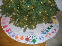 i saw this once before. LOVE the idea of putting our handprints on a tree shirt and see how my kids grow