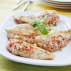 Feta-Stuffed Chicken Breasts  ~ Crumbled feta teams up with sun-dried tomatoes and fresh basil to upgrade your dinner in less than a half hour! ~ from www.bhg.com