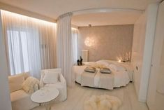 Romantic white bedroom. like the curtain partition