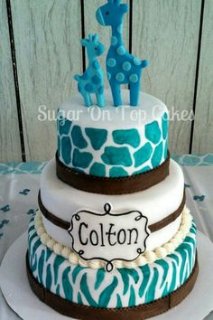 3 tier brown and turquoise baby shower cake with zebra print and giraffe print. Facebook.com/SugarOnTopCakes