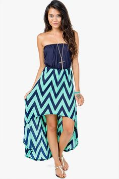 Keep it cute and casual in easy summer dresses. Blouson top. Zig zag printed skirt. Hi-lo silhouette. Strapless.