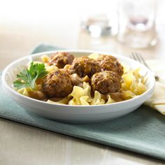 A savory twist on an old favorite, with a dash of extra fiber to boot! These delicious meatballs are enriched with All-Bran® cereal and shredded cheddar cheese for a zingy taste. Serve over hot buttered egg noodles, topped with savory onion sauce, for an easy, family-style dinner.