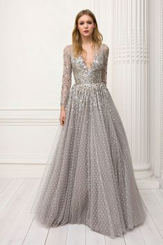 Jenny Packham Pre-Fall 2018: I'm obsessed with the grey gown with a mix of sequins and embellishments! I like how the gown has long sleeves!