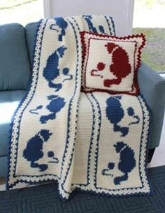 "Design by: Maggie Weldon Skill Level: Intermediate Size: Afghan:46"" x 70"" Pillow: 20"" x 20"" Materials: Lt. Bulky Weight Yarn: Afghan: White (MC) – 42 oz, 1890 yds (1190 grams, 1722 meters) Denim (CC)"