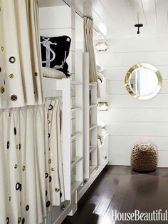 The bunk room feels like a ship's cabin and is lined with six bunks, four on one side and two on the other. Grommets on the curtains are meant to evoke bubbles.