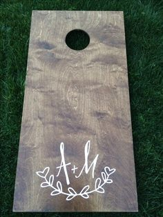 I LOVE the look of these cornhole boards! Instead of the A+M just a W would be cute! :)  Maybe we could figure out how to make one!!