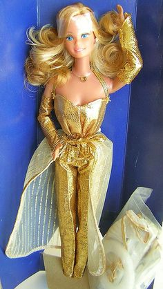Golden Dreams Barbie. Oooh flashback! Either my sister or I had this one too, can't remember but the skirt seems familiar.
