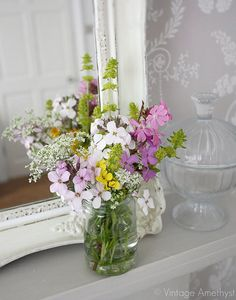 Wildflowers in a glass are right up my alley. Why have I never thought to put a mirror on a mantle? I like it.