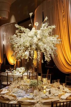 Full White Floral Centerpiece    Photography: Nakai Photography   Read More:  http://www.insideweddings.com/weddings/new-years-eve-wedding-with-glittering-metallic-details-in-chicago/787/