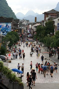 Day 162: After the rain let up, we rode Snow Lion's shuttle down to Yangshuo's West Street, a lively narrowing street packed with cart vendors, boutiques, and restaurants.