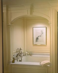 I am going to enclose my tub like this when I remodel. It adds such elegance to a room