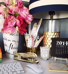 Personalize your work space! This office space is totally a Party Girls office and we are absolutely loving it. Navy and white striped lamp and gold accents, way way way cute!