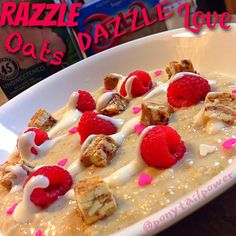 1/3 cup old fashioned oats 2/3 cup water  2/3 cup love  1 tbsp WF pancake syrup  Microwave for 3:00 Whisk in 1/4 cup liquid egg whites and more love   Microwave for :30 Whisk and repeat Top with chunks of white chocolate Raspberry quest bar bites  Organic razz-bizzles Sprinkles of love Cheesecake yogurt drizzle {{•Greek yogurt •sf ff cheesecake pudding •@SweetLeaf Stevia Sweetener English toffee drops •@so_delicious unsweetened coconut milk to desired consistency}}