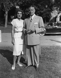 Jacqueline Bouvier and John Bouvier III    Portrait of Jacqueline Bouvier standing on a lawn with her father John Bouvier III. East Hampton, Long Island, New York.July 23, 1947.