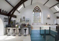 Lovely cruck shaped roof. gothic kitchen. home decor and interior decorating ideas. stained glass