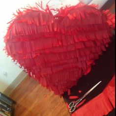 Heart shaped piñata for our wedding! Filled with favorite candies. Can't wait to cut loose on it!!