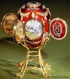 Caucasus egg by Fabergé, 1893, commemorates the Imperial hunting lodge in Abastumani in Caucasus where Grand Duke George spent most of his life after being diagnosed with tuberculosis. Miniatures were painted and signed by Krijitski. The miniatures are revealed by opening four pearl-bordered doors around the egg. Each door bears a diamond-set numeral of the year, forming the date 1893. Behind the hinged cover at the top is a portrait of the Grand Duke in his naval uniform.